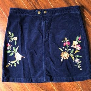 Floral embroidered navy blue corduroy skirt.